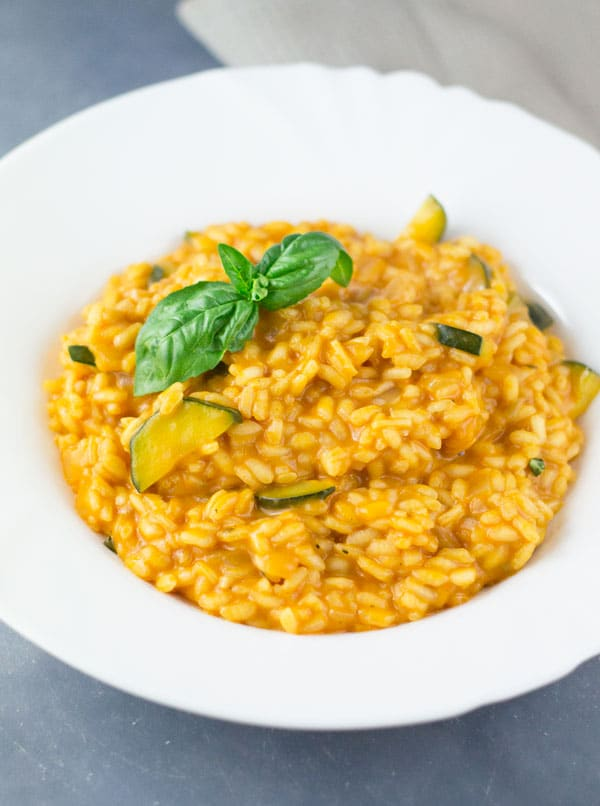 Creamy Tomato Zucchini Risotto, an easy weeknight meal made with few ingredients and simple flavours. insidetherustickitchen.com