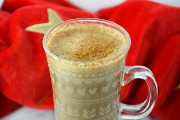 Close up of banana milk coffee topped with cinnamon
