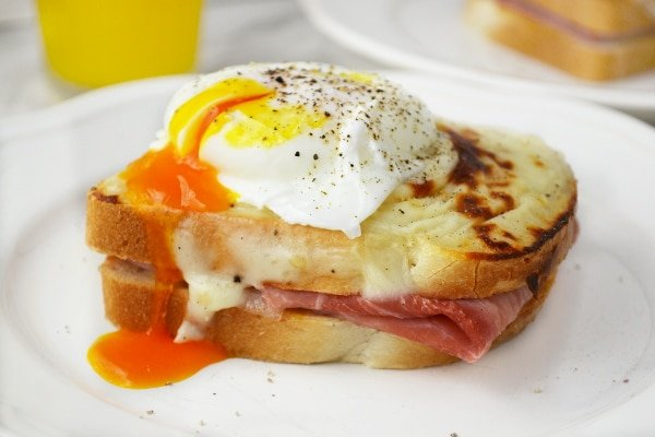 Croque Madame - mustard and ham toasts topped with a cheesy bechamel sauce and a perfectly cooked poached egg. Breakfast heaven.