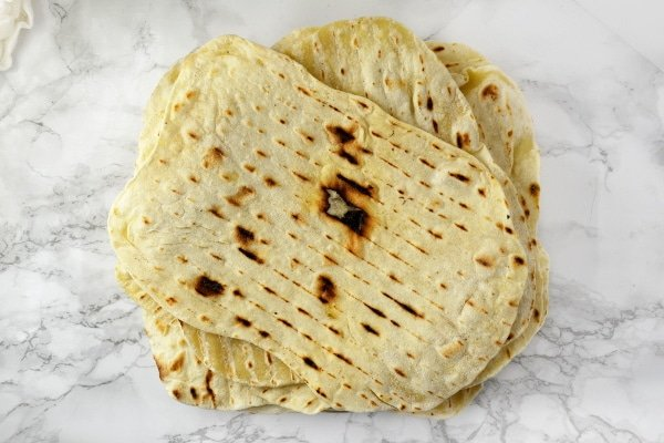 Make perfect flatbreads at home with this simple and easy recipe. They're full of flavour and cost less than half price than shop bought flatbreads. Insidetherustickitchen.com