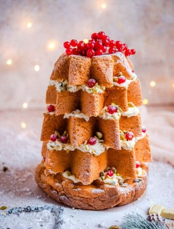 A pandoro christmas cake topped with redcurrants and nuts