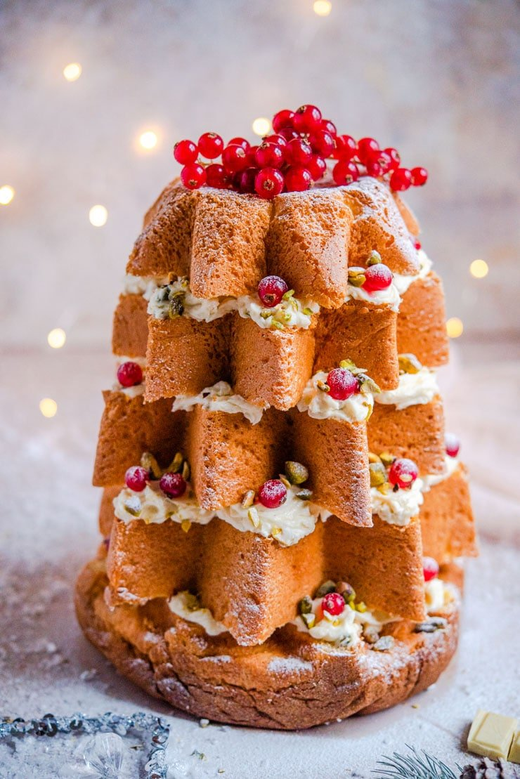 A close up of a pandoro christmas tree cake