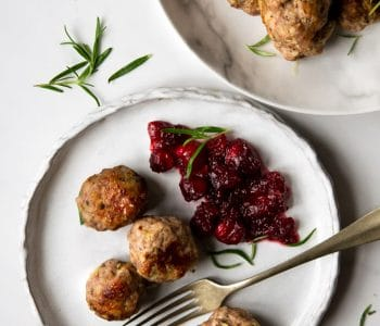 Sausage stuffing balls on a rustic plate