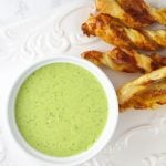 You will love this Sour Cream Pesto Dip with Prosciutto Dippers Recipe. Homemade pesto is swirled with sour cream and served with mustard, Parmesan and Prosciutto pastry twists. www.insidetherustickitchen.com