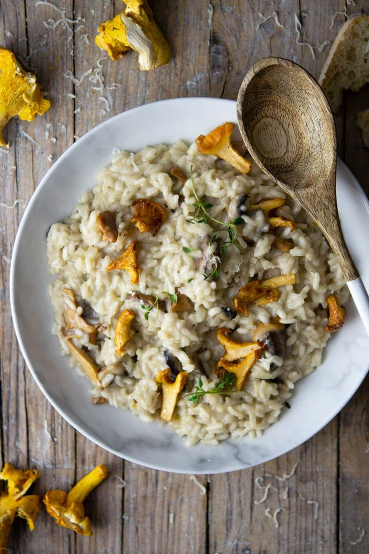 AN overhead shot of creamy mushroom risotto with chanterelle mushrooms