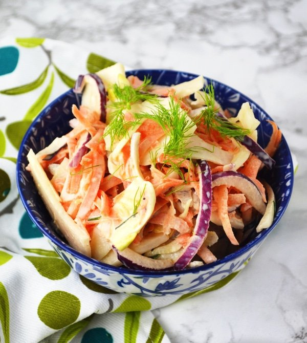 This delicious and easy Fennel Slaw recipe is the perfect healthy side dish to grilled chicken or fish and takes no time to make. www.insidetherustickitchen.com