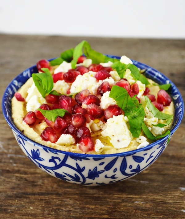 This Hummus Dip with Pomegranate and Feta is so delicious that it'll convince you to NEVER buy shop bought hummus ever again! www.insidetherustickitchen.com