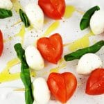 These fun Valentine's Caprese Skewers are a perfect fuss free appetizer using classic Italian ingredients you can't go wrong! www.insidetherustickitchen.com