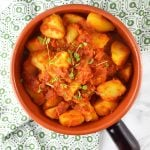 Patate Rifatte (redone potatoes) are a great potato side dish made from leftover boiled potatoes, fried with garlic and herbs and cooked in a delicious tomato sauce. www.insidetherustickitchen.com