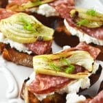 These roasted fennel, salami, and ricotta crostini are so easy to make and utterly delicious. Make these for a delightful Springtime lunch out in the garden. www.iinsidetherustickitchen.com