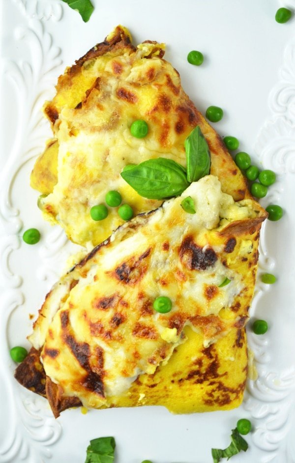 These Crespelle (savoury crepes) are stuffed with ricotta, peas and ham and baked with a delicious Fontina cheese sauce! www.insidetherustickitchen.com