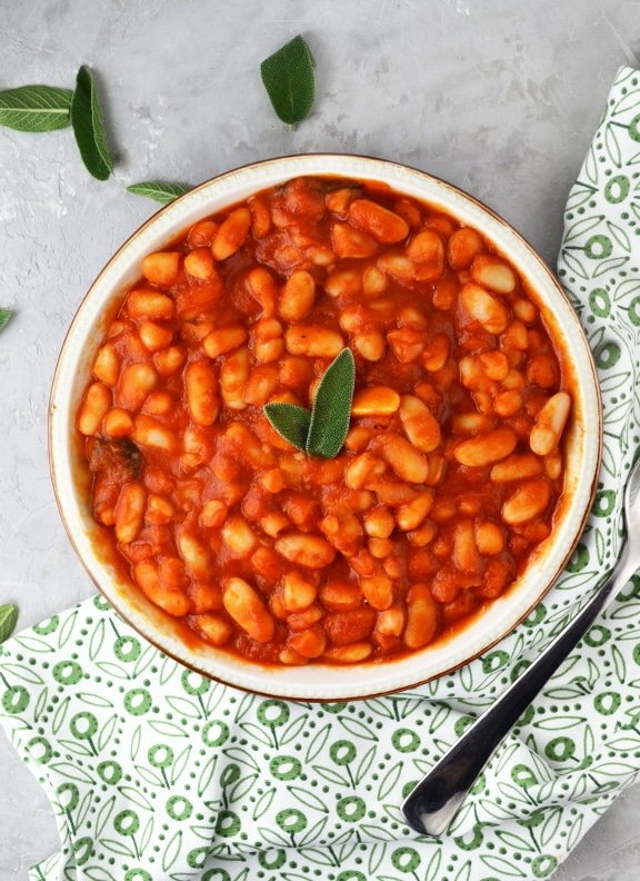 Fagioli all'uccelletto (beans in tomato sauce) is a delicious Italian side dish made with cannellini beans, tomato, garlic, and sage www.insidetherustickitchen.com
