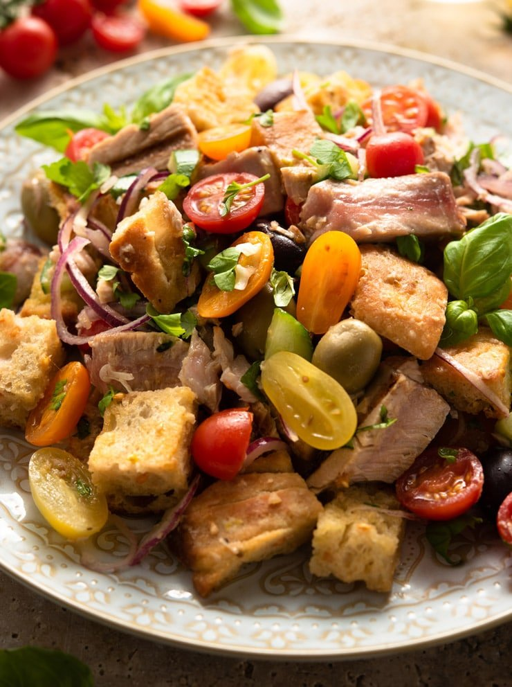 A close up of a tuna panzanella salad on a large serving plate