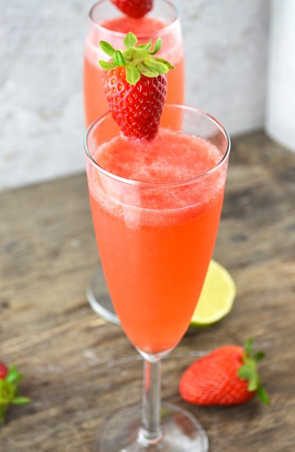 These delicious strawberry bellini are a refreshing Prosecco cocktail made with fresh strawberries and zesty lime juice www.insidetherustickitchen.com
