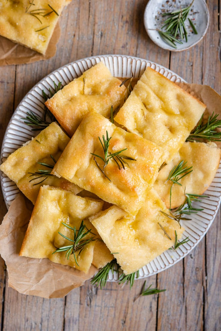 An overhead shot of rosemary focaccia on a plate