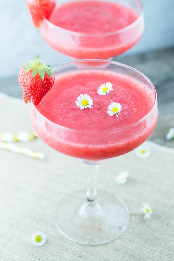 Prosecco Strawberry Slushie made with only 3 ingredients, it's the perfect way to cool down and relax this Summer! Insidetherustickitchen.com