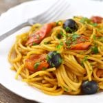 A fantastic Spaghetti alla Puttanesca recipe using fresh cherry tomatoes, capers, olives and garlic it's packed full of flavour and ready in minutes! insidetherustickitchen.com