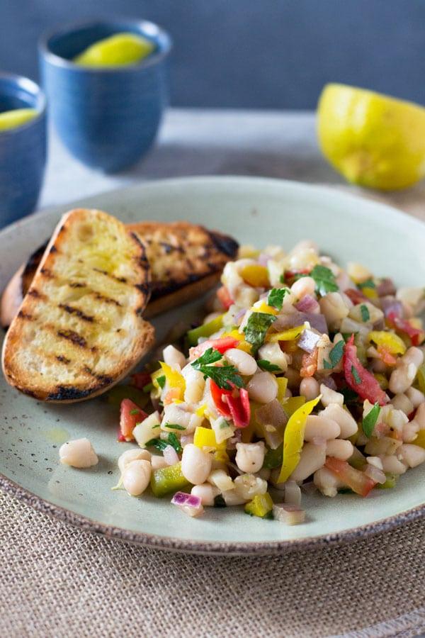 Warm easy bean salad with eggplant, tomato, garlic and fresh herbs. Insidetherustickitchen.com
