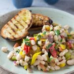A warm easy bean salad recipe with yellow pepper, eggplant, tomatoes, garlic and delicious fresh herbs. This makes a perfect easy, simple and delicoius dinner or lunch alongside some char grilled crusty bread. insidetherustickitchen.com
