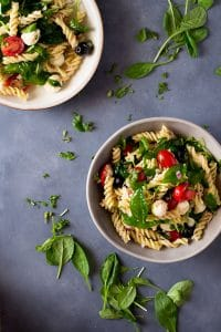 A super easy tuna pasta salad packed full of delicious Italian flavours. Mozzarella balls, spinach, cherry tomatoes, black olives and a simple oregano dressing. Great for picnics or a quick and easy lunch recipe. insidetherustickitchen.com