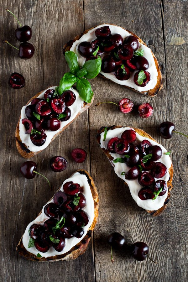 Whipped ricotta toast with balsamic cherries inside the rustic kitchen