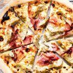 A close up of an artichoke pizza