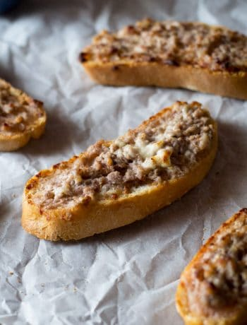 This two ingredient stracchino and sausage crostini is so simple and crazy delicious. Tangy, soft cheese is mixed with Italian sausage and spread on some thick crusty bread. An easy sausage crostini recipe you're sure to love. More authentic italian recipes at Insidetherustickitchen.com