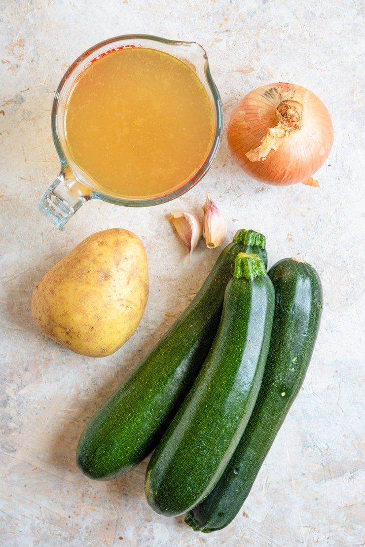 An overhead shot of ingredients used to make creamy zucchini soup
