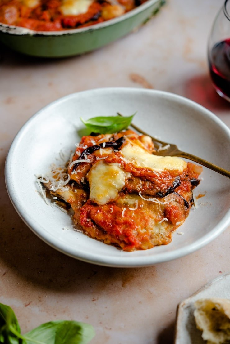 Eggplant parmigiana in a bowl with a fork