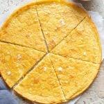 A close up of la farinata flatbread on a stone worktop