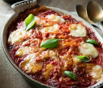 Parmigiana di Melanzane - eggplant parmigiana. An authentic Italian recipe made with fried eggplant/aubergines, tomato sauce, mozzarella and parmesan. Utterly delicious and comforting and so simple to make, a real family favourite. Authentic Italian recipes and traditional Italian recipes at Inside The Rustic Kitchen.