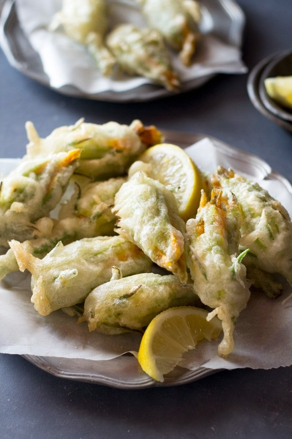 Crispy fried zucchini flowers stuffed with ricotta, chili flakes and lemon Inside the rustic kitchen