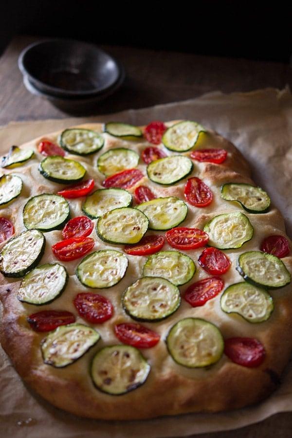 zucchini tomato focaccia inside the rustic kitchen