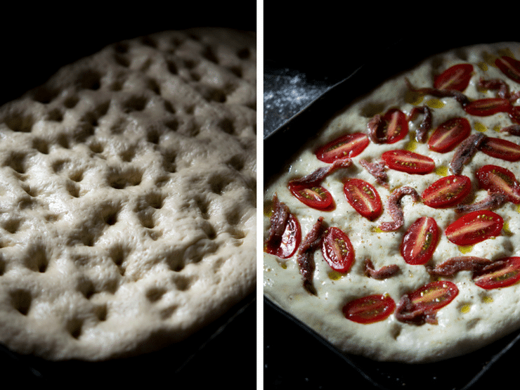 Close up of cherry tomato focaccia with anchovies before going in the oven