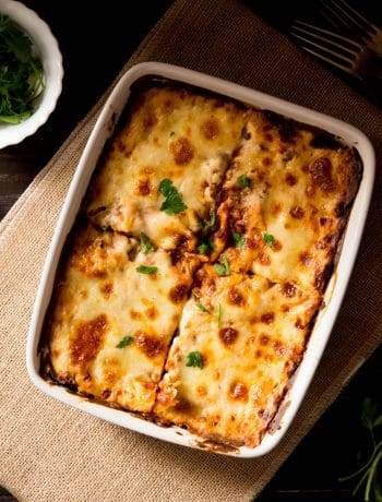 Lentil ragu lasagne in a baking dish cut into four