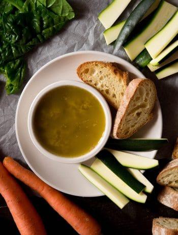 Simple bagna cauda recipe in a ramekin with chopped vegetables