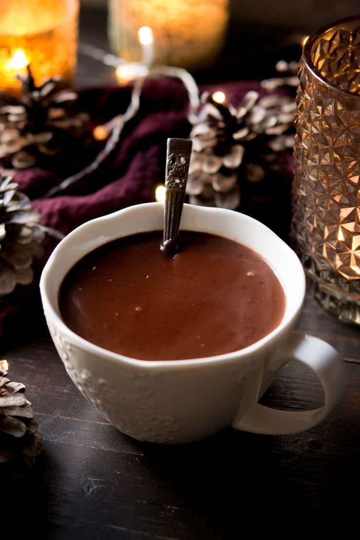 Italian hot chocolate in a white mug with a spoon