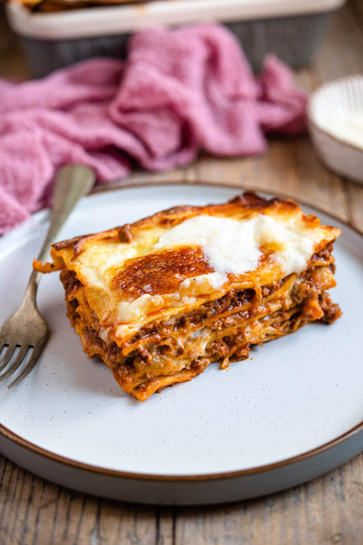 A slice of beef lasagna on a plate