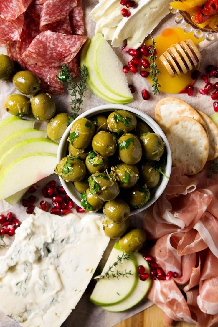 Marinated olives on a ramekin on an antipasto platter