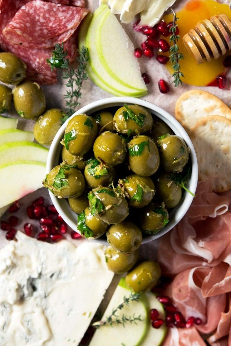 A close up of marinated olives in a ramekin
