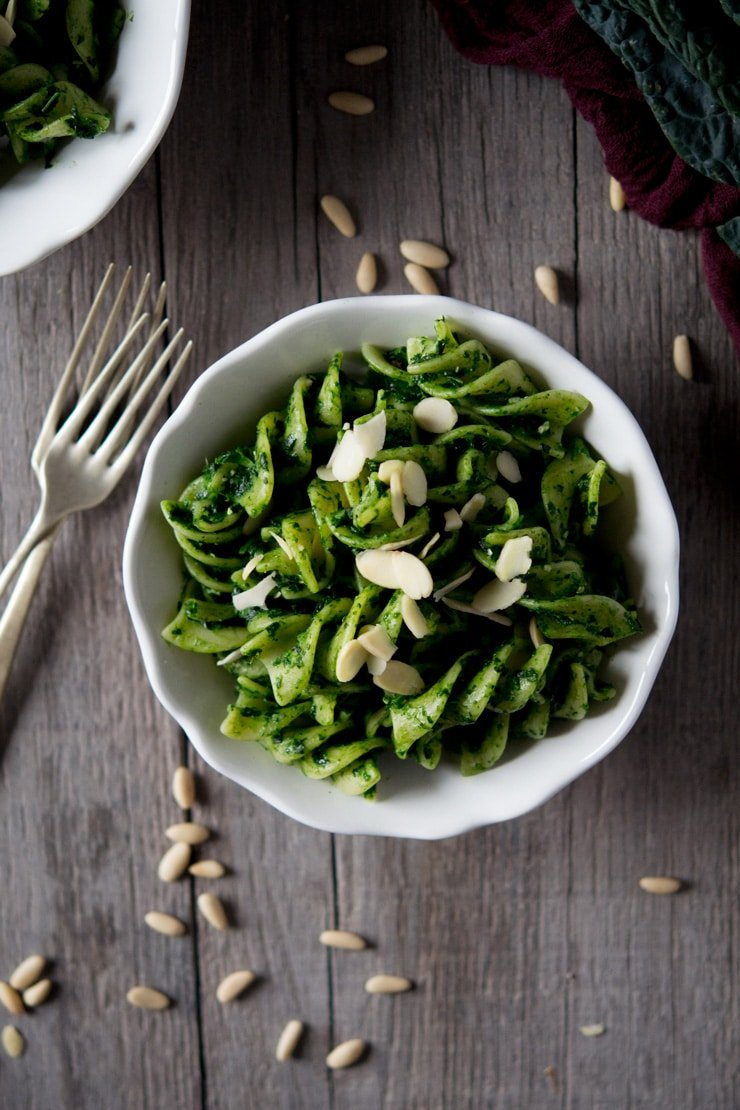Pesto pasta sauce made with cavolo nero in a white bowl on a wooden surface