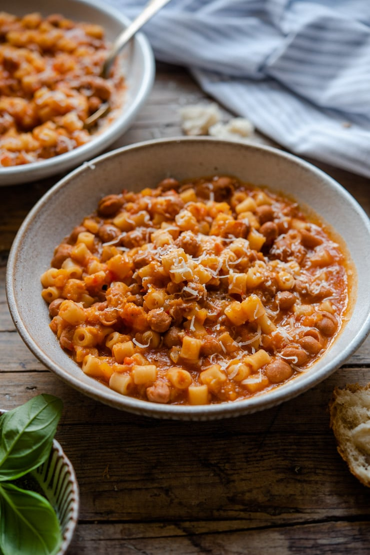 Pasta fagioli soup in a rustic bowl with crusty bread