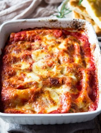 spinach and ricotta cannelloni in a large baking dish