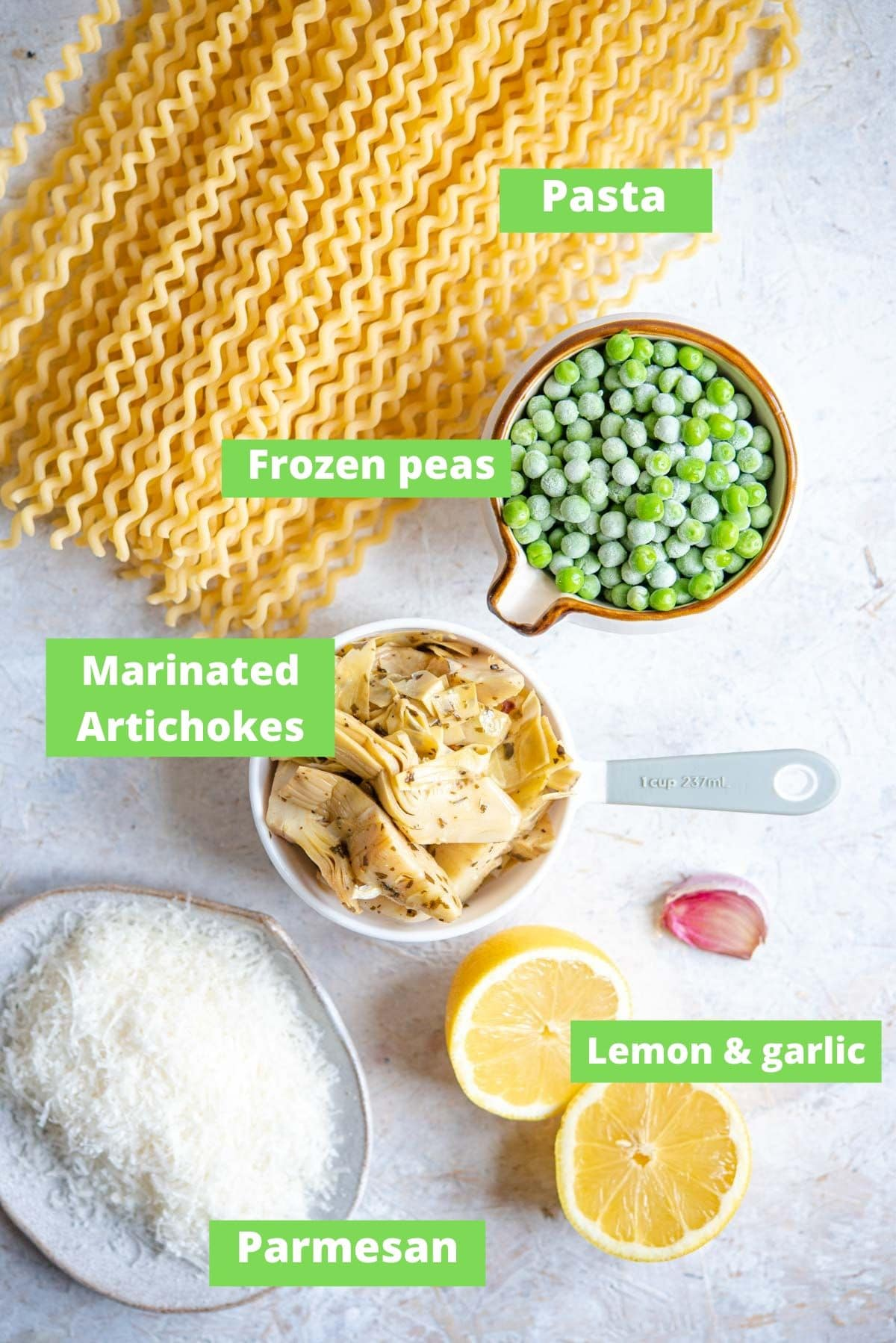 An overhead shot of ingredients for making artichoke pasta