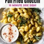A graphic with a photo of pan fried gnocchi with the recipe name over it