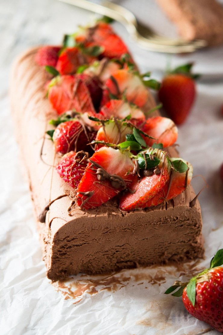 A close up of a chocolate semifreddo topped with strawberries, an easy semifreddo recipe