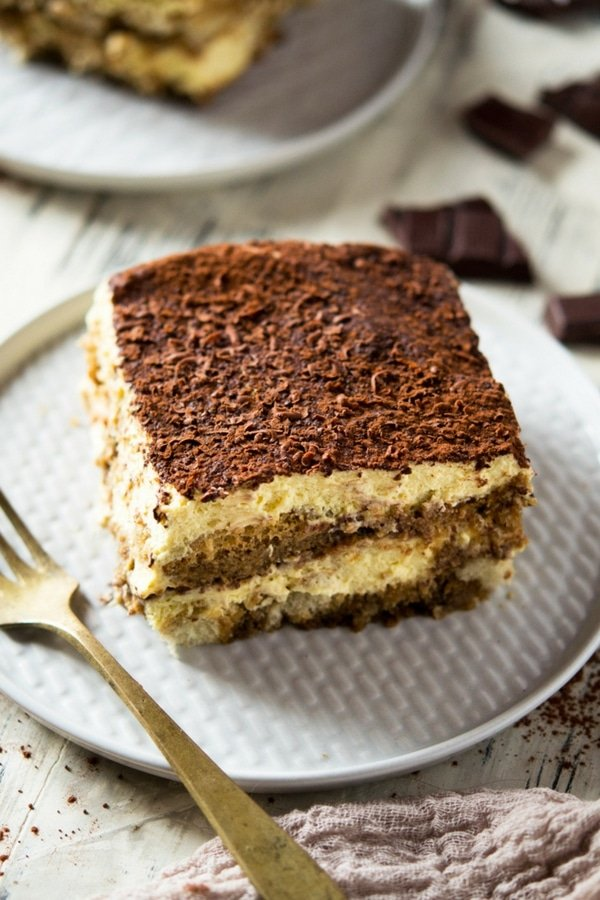 Easy Tiramisu. This Tiramisu is the best ever recipe I've tried. Made with all the classic flavors, no heavy cream but instead with mascarpone cheese. This glorious authentic Italian dessert is a sure crowd pleaser and will never let you down! Insidetherustickitchen.com #Tiramisu #Italiandesserts #Easytiramisu #dessertrecipes #Italianfood
