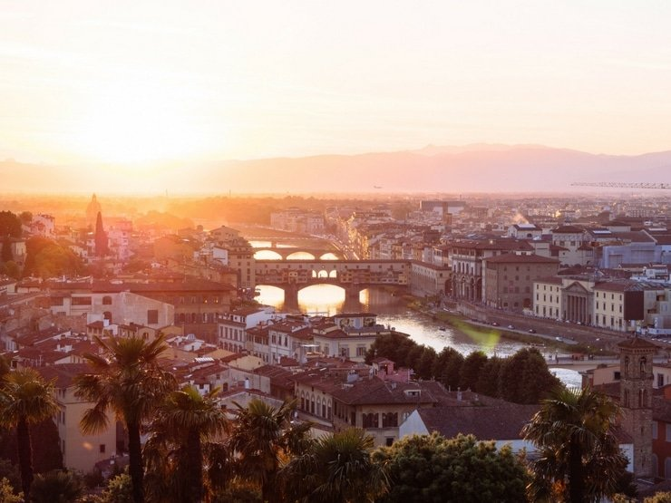 A photo of the city of Florence and the Ponte Vecchio at sunset
