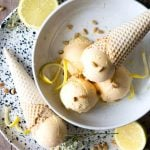 A cropped image of scoops of lemon ice cream in a bowl