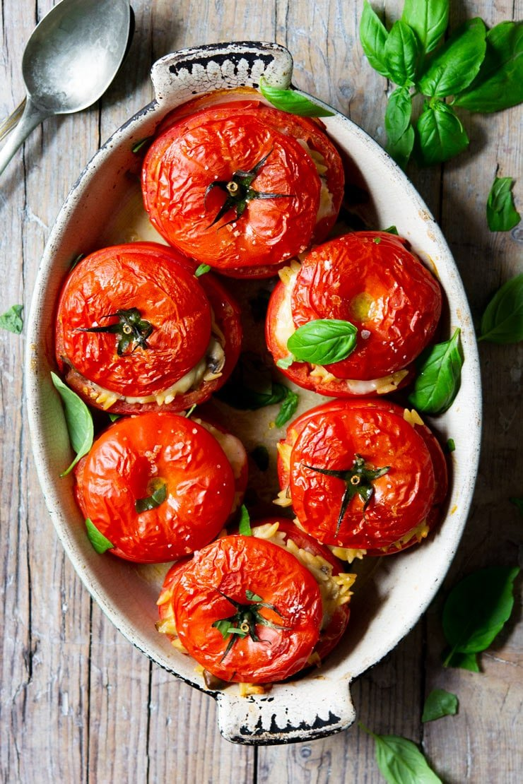 6 stuffed tomatoes in an oval baking dish